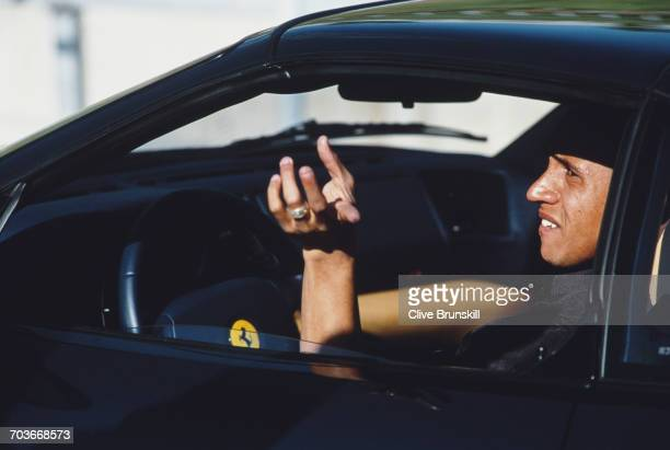 Roberto Carlos of Brazil and Real Madrid Football Club poses for a portrai talongside a Ferrari 355 F1 GTS for soft drinks manufacturer PepsiCola on...