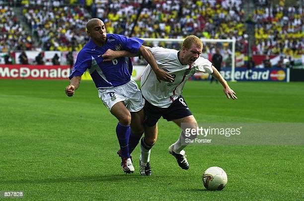 Roberto Carlos of Brazil closes down Paul Scholes of England during the England v Brazil World Cup Quarter Final match played at the Shizuoka Stadium...