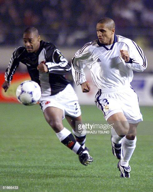 Roberto Carlos of Real Madrid and Vasco Da Gama's Vagner chase the ball during the first half of the Toyota Cup intercontinental football club...