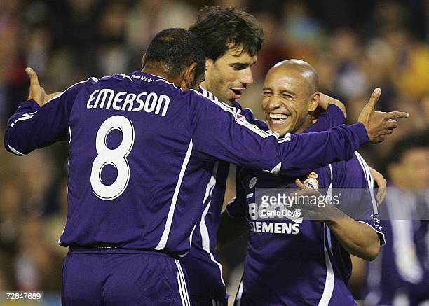 Roberto Carlos of Real Madrid celebrates with Emerson after they scored their first goal during their La Liga match between Valencia and Real Madrid...