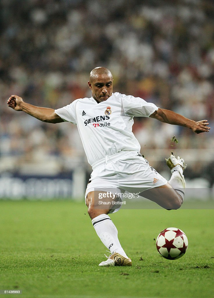 Roberto Carlos of Real Madrid in action during the UEFA Champions League Group B match between Real Madrid and Roma at the Santiago Bernabeu Stadium on September 28, 2004 in Madrid, Spain.