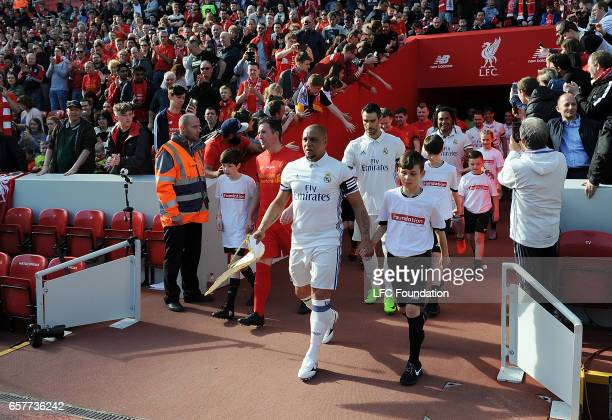 Roberto Carlos of Real Madrid Legends leads his team out before the LFC Foundation Charity Match between Liverpool Legends and Real Madrid Legends at...