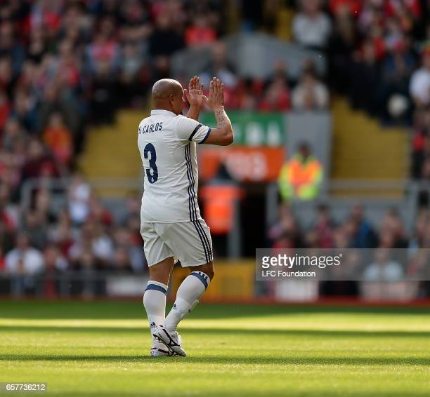 Roberto Carlos of Real Madrid Legends shows his appreciation to the fans during the LFC Foundation Charity Match between Liverpool Legends and Real...