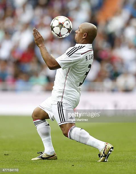 Roberto Carlos of Real Madrid Leyendas controls the ball during the Corazon Classic charity match between Real Madrid Leyendas and Liverpool Legends...
