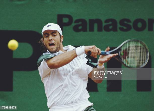 Roberto Carretero of Spain makes a backhand return against compatriot vÄlex Corretja during their Men's Singles Final match at the Panasonic German...
