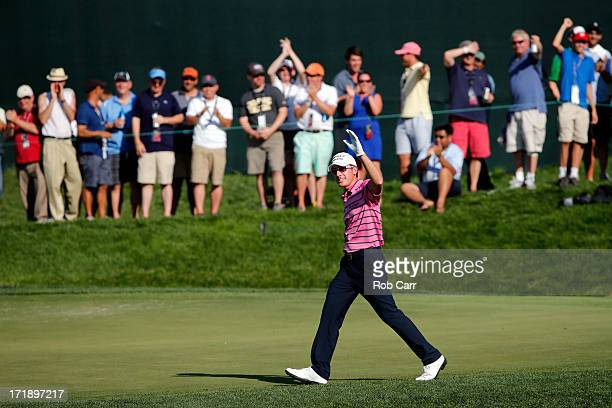 Roberto Castro celebrates after chipping in to save par on the 18th hole during Round Three of the ATT National at Congressional Country Club of the...