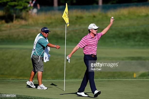 Roberto Castro celebrates with his caddie Rusty Stark after chipping in to save par on the 18th hole during Round Three of the ATT National at...