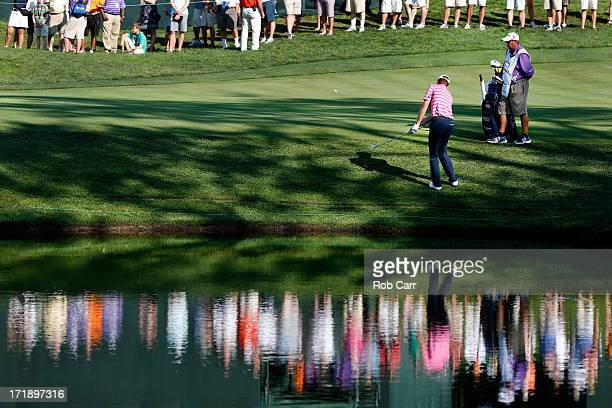 Roberto Castro chips in to save par on the 18th hole during Round Three of the ATT National at Congressional Country Club of the on June 29 2013 in...