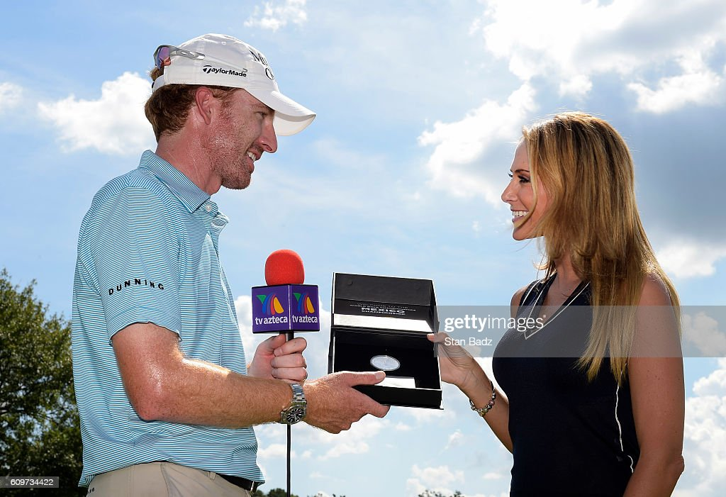 Roberto Castro is presented a WGC Mexico Championship silver coin from Ines Soinz during practice for the TOUR Championship, the final event of the FedExCup Playoffs, at East Lake Golf Club on September 20, 2016 in Atlanta, Georgia.