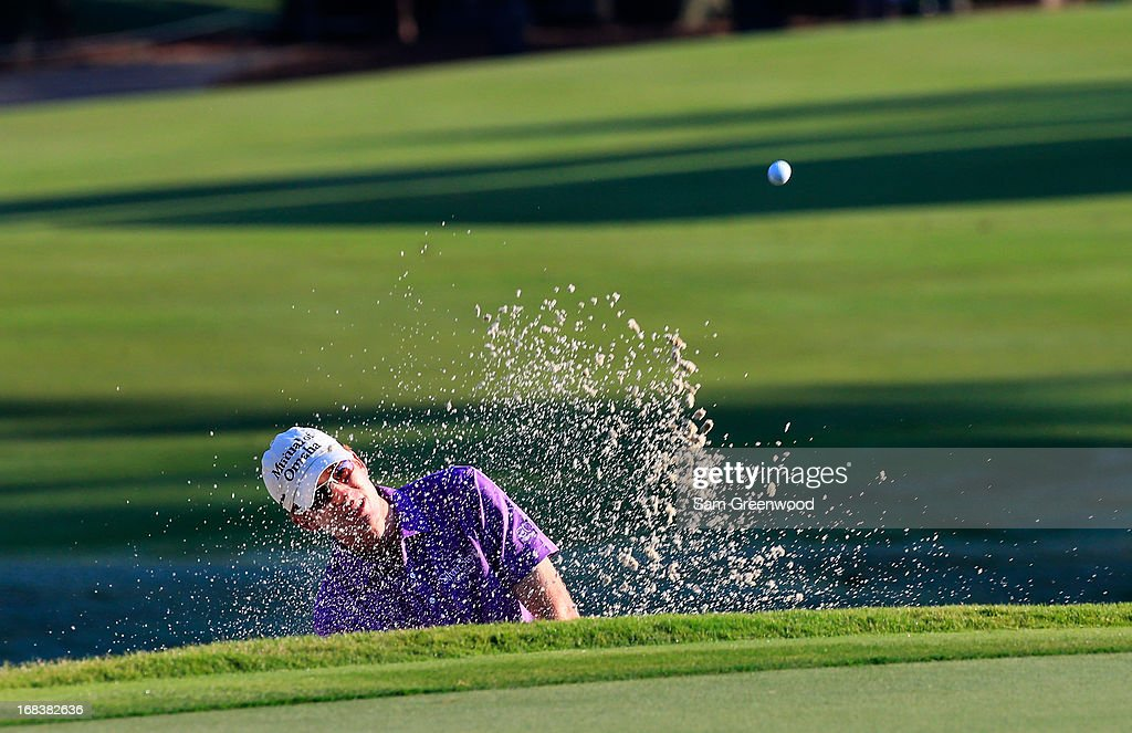 Roberto Castro of the USA plays a shot from a bunker on the 11th hole during round one of THE PLAYERS Championship at THE PLAYERS Stadium course at TPC Sawgrass on May 9, 2013 in Ponte Vedra Beach, Florida.