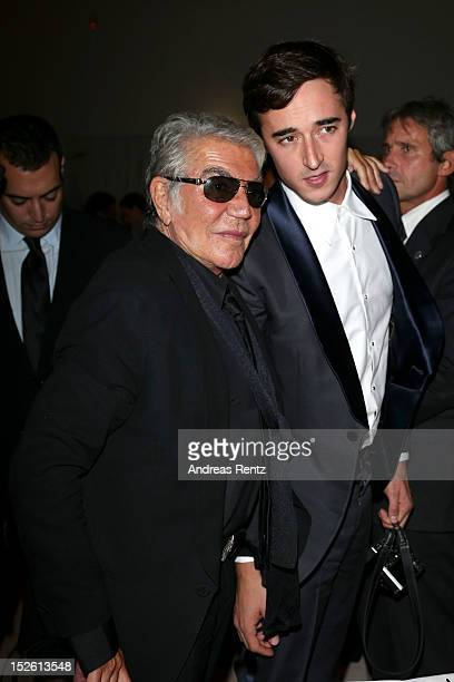 Roberto Cavalli and Daniele Cavalli attend the amfAR Milano 2012 Dinner during Milan Fashion Week at La Permanente on September 22 2012 in Milan Italy