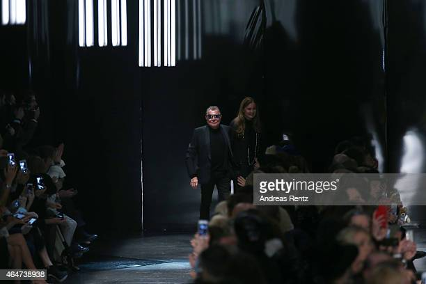 Roberto Cavalli and Eva Cavalli acknowledge the applause of the audience after the Roberto Cavalli show during the Milan Fashion Week Autumn/Winter...