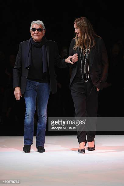 Roberto Cavalli and Eva Cavalli walk the runway after the Just Cavalli show as part of Milan Fashion Week Womenswear Autumn/Winter 2014 on February...