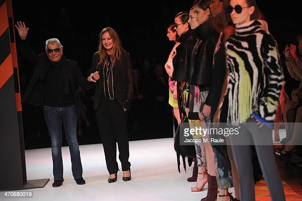 Roberto Cavalli and Eva Cavalli walk the runway during the Just Cavalli show as part of Milan Fashion Week Womenswear Autumn/Winter 2014 on February...