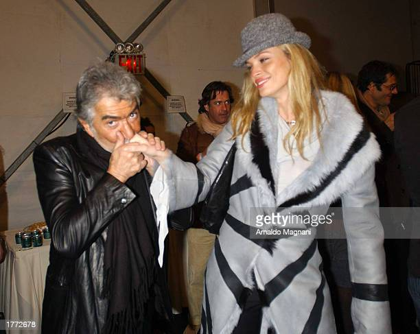 Roberto Cavalli and model Ester Canadas attend the Luca Luca fall fashion show February 9 2003 during MercedesBenz Fashion Week in New York City