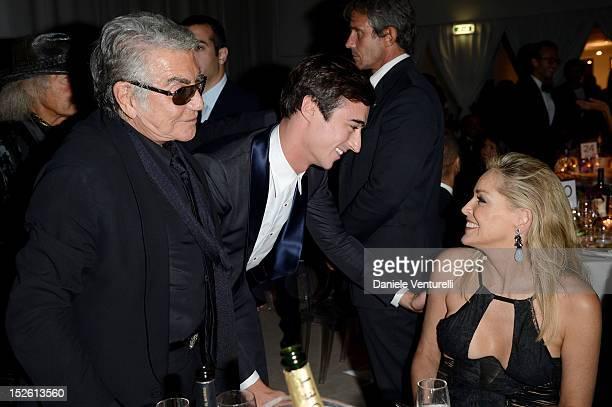 Roberto Cavalli Daniele Cavalli and Sharon Stone attend the amfAR Milano 2012 Dinner during Milan Fashion Week at La Permanente on September 22 2012...