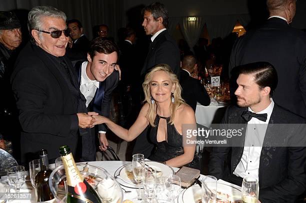 Roberto Cavalli Daniele Cavalli Sharon Stone and Martin Mica attend the amfAR Milano 2012 Dinner during Milan Fashion Week at La Permanente on...