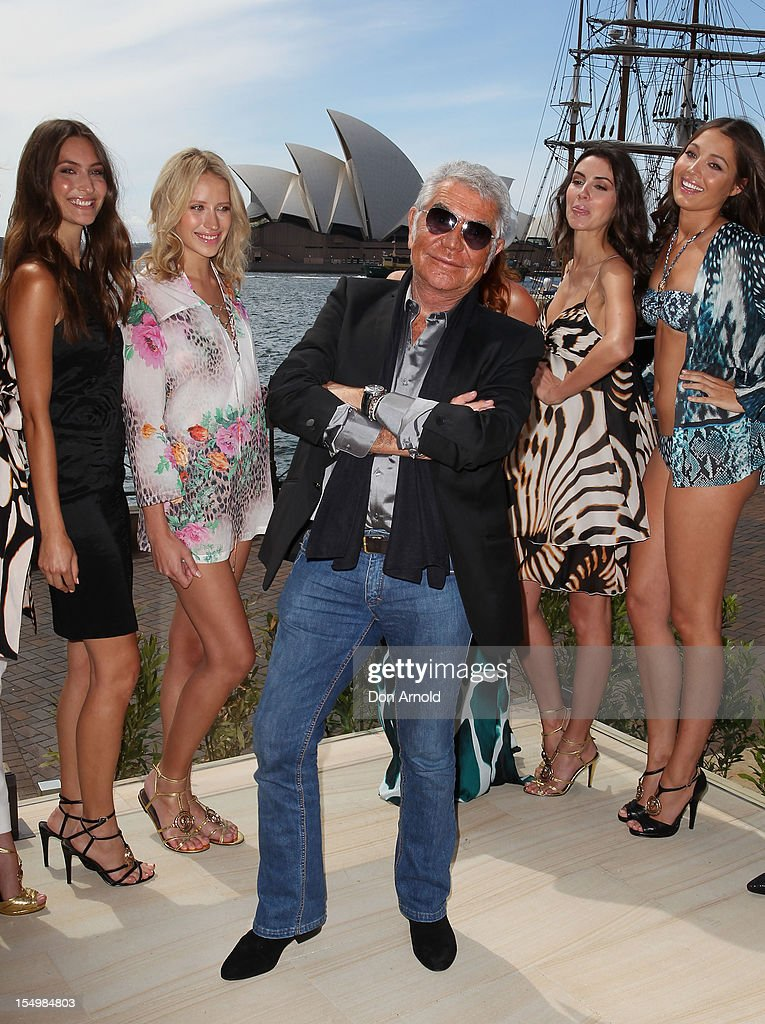 Roberto Cavalli poses alongside models during his press conference announcing his range for Target at the Park Hyatt on October 30, 2012 in Sydney, Australia.
