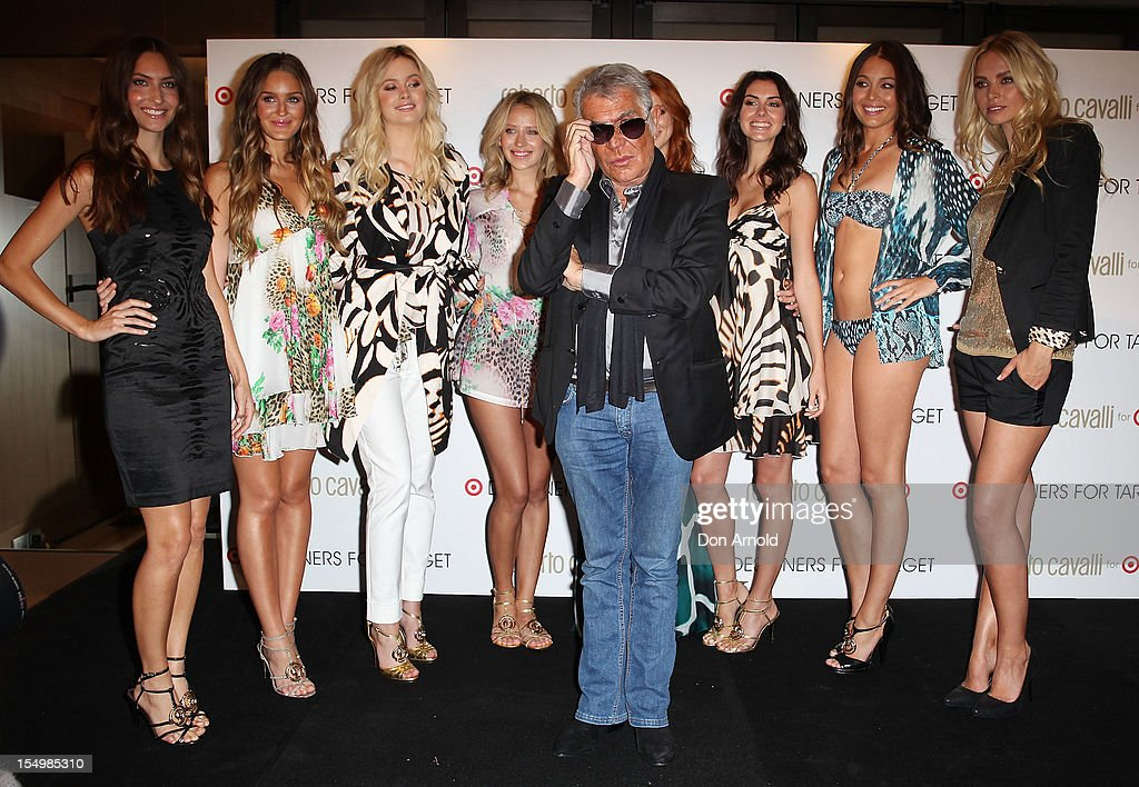 Roberto Cavalli poses alongside models during his press conference to announce his range for Target at the Park Hyatt on October 30, 2012 in Sydney, Australia.