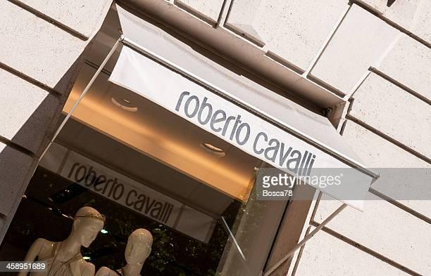 roberto cavalli window shop in rue montaigne, paris - roberto cavalli designer label stock pictures, royalty-free photos & images