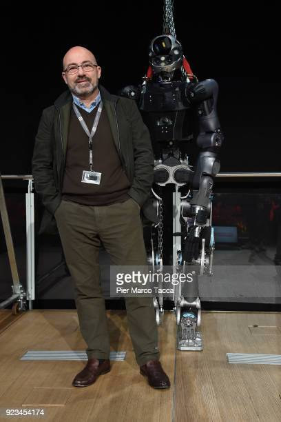 Roberto Cingolani scientific director of the Italian Institute of Technology and the robot WalkMan pose during the launch of Corriere Innovazione at...