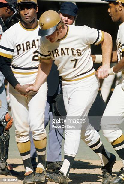 Roberto Clemente Bob Robertson and Willie Stargell of the Pittsburgh Pirates walk off field during the World Series against the Baltimore Orioles at...