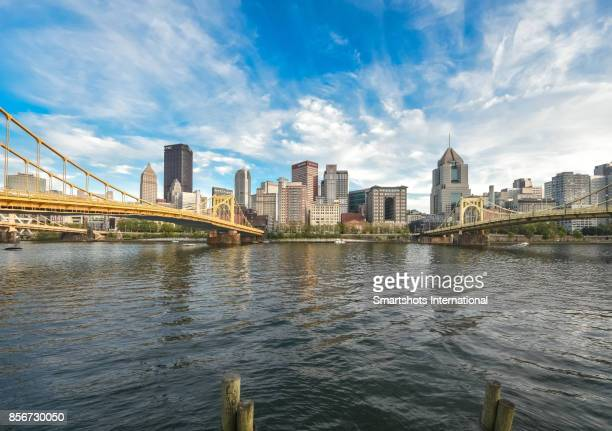 Roberto Clemente bridge and Andy Warhol bridge spanning over the Allegheny river with Pittsburgh skyline on background, Pennsylvania, USA