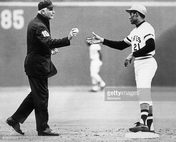 9/30/1972 Roberto Clemente made his 3000 hit Doug Harvey umpire is shown handing him the ball on the field