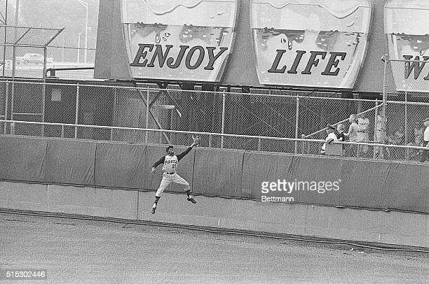 Roberto Clemente of the Pittsburgh Pirates catching a field ball.