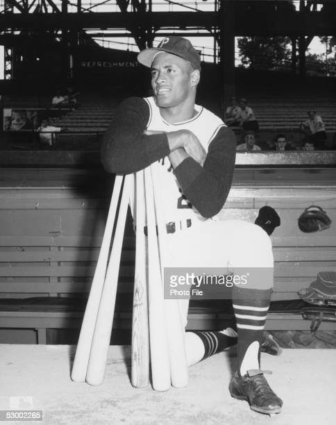 Roberto Clemente of the Pittsburgh Pirates poses with bats before a season game Roberto Clemente played for the Pittsburgh Pirates from 19551972