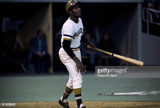 Roberto Clemente of the Pittsburgh Pirates watches his ball fly during the World Series against the Baltimore Orioles at Three Rivers Stadium on...