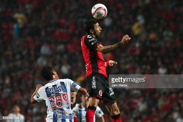 Roberto de la Rosa of Pachuca and Alejandro Donatti of Tijuana go for a header during the seventh round match between Tijuana and Pachuca as part of...