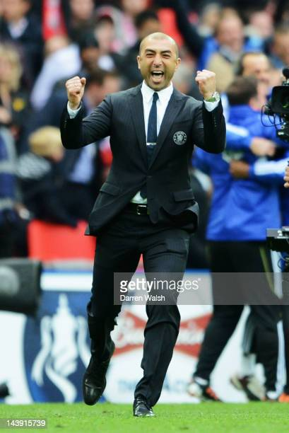 Roberto Di Matteo caretaker manager of Chelsea celebrates victory in the FA Cup Final with Budweiser between Liverpool and Chelsea at Wembley Stadium...