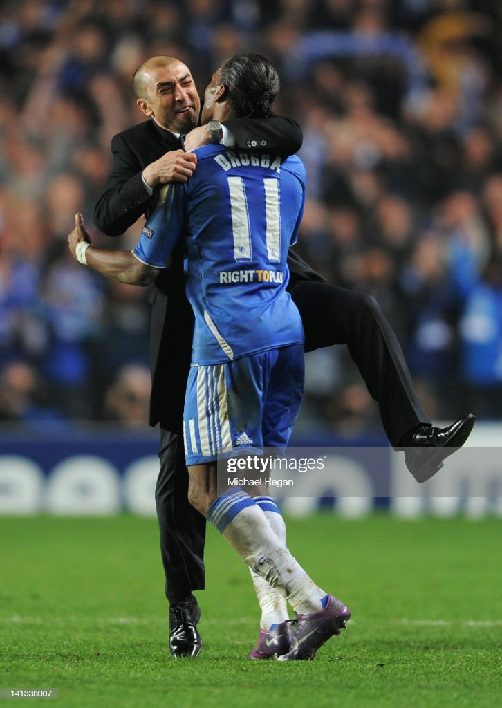 Roberto Di Matteo caretaker manager of Chelsea celebrates victory with Didier Drogba after the UEFA Champions League Round of 16 second leg match between Chelsea FC and SSC Napoli at Stamford Bridge on March 14, 2012 in London, England.