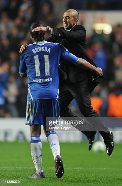 Roberto Di Matteo caretaker manager of Chelsea celebrates victory with Didier Drogba after the UEFA Champions League Round of 16 second leg match...