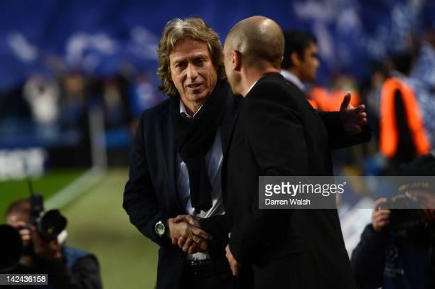 Roberto Di Matteo caretaker manager of Chelsea greets Head Coach Jorge Jesus of Benfica during the UEFA Champions League Quarter Final second leg...