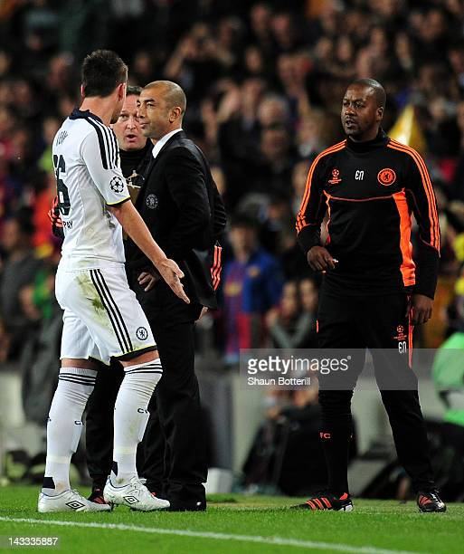 Roberto Di Matteo caretaker manager of Chelsea looks to John Terry of Chelsea after he was sent off during the UEFA Champions League Semi Final...