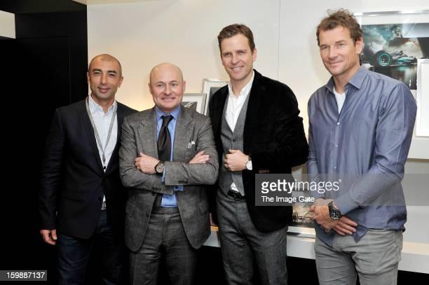 Roberto Di Matteo, Georges Kern, Oliver Bierhoff and Jens Lehmann visit the IWC booth during the Salon International de la Haute Horlogerie 2013 at...
