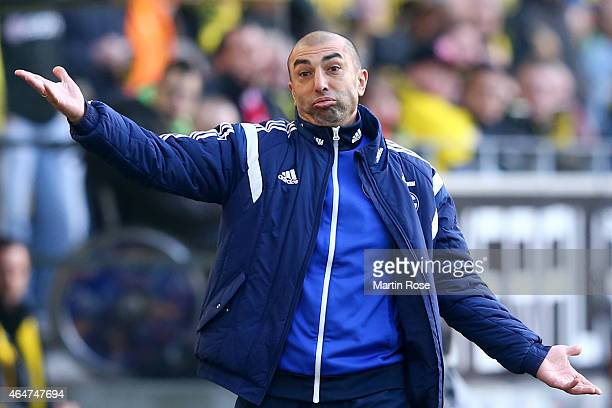 Roberto Di Matteo head coach of Schalke gives instructions to his players during the Bundesliga match between Borussia Dortmund and FC Schalke 04 at...