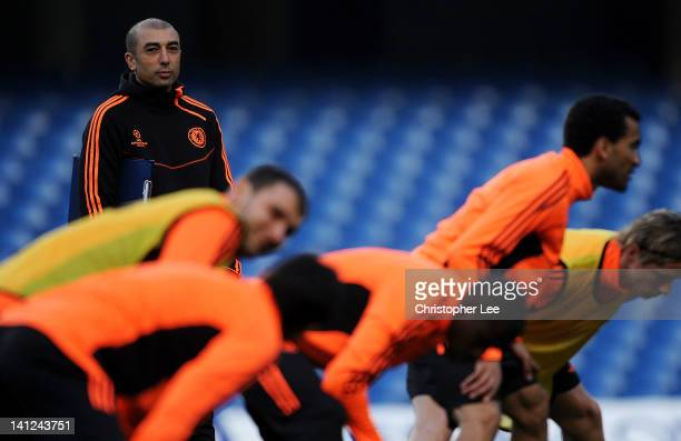 Roberto Di Matteo interim first team coach watches over his players during a training session ahead of the UEFA Champions League round of sixteen...