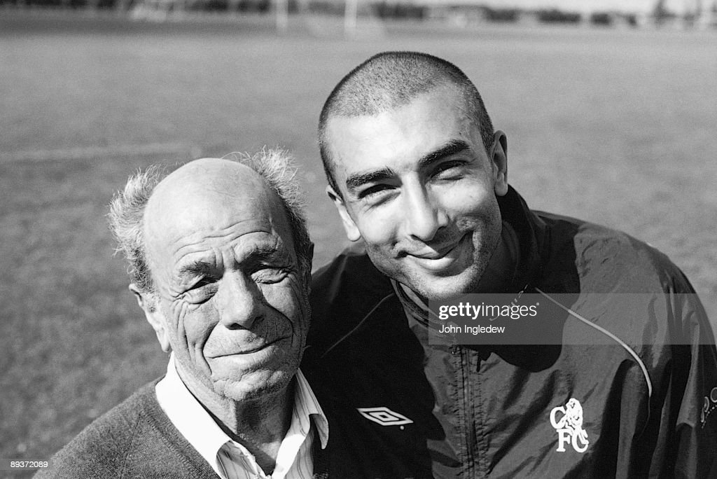 Roberto Di Matteo of Chelsea with Gianfranco Zola's father poses for a photo after training during the 2002/03 season at the Harlington training ground, in London.