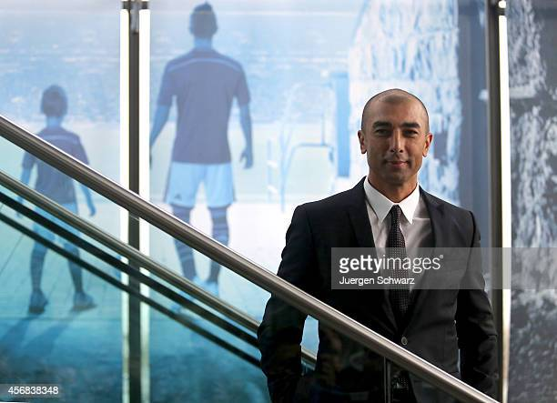 Roberto Di Matteo the newly appointed head coach of FC Schalke 04 arrives for a press conference at VeltinsArena on October 8 2014 in Gelsenkirchen...