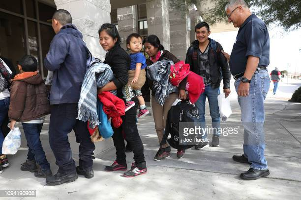 Roberto Diaz welcomes migrants to an Annunciation House facility as they arrive to be cared for after being released by the US Immigration and...