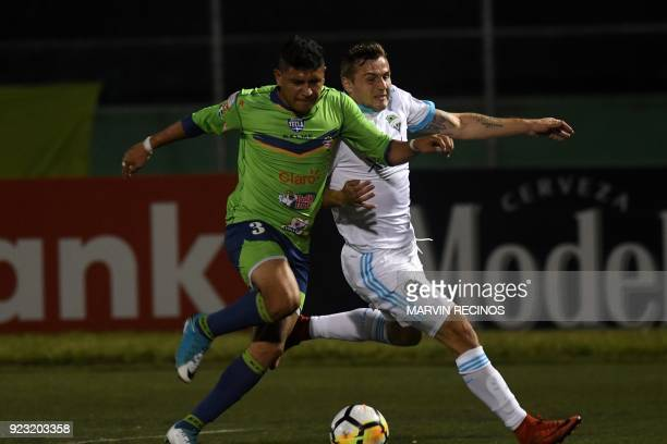 Roberto Domingez of Santa Tecla FC fights for the ball with Jordan Morris of the Seattle Sounders during the CONCACAF Champions League football match...