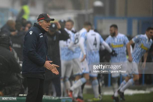 Roberto Donadoni head coach of Bologna FC reacts as the players of Spal celebrate after scoring a goal during the serie A match between Spal and...