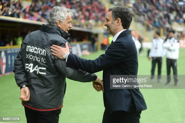 Roberto Donadoni head coach of Bologna FC shakes hand with Franco Pecchia head coach of Hellas Verona FC during the serie A match between Bologna FC...