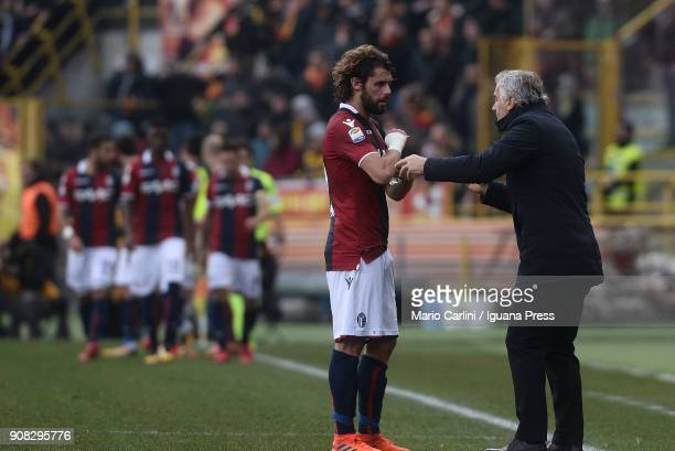 Roberto Donadoni head coach of Bologna FC talks to his player Andrea Poli during the serie A match between Bologna FC and Benevento Calcio at Stadio...