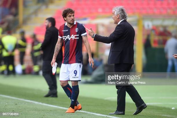 Roberto Donadoni head coach of Bologna FC talks to his player Simone Verdi during the serie A match between Bologna FC and AC Milan at Stadio Renato...