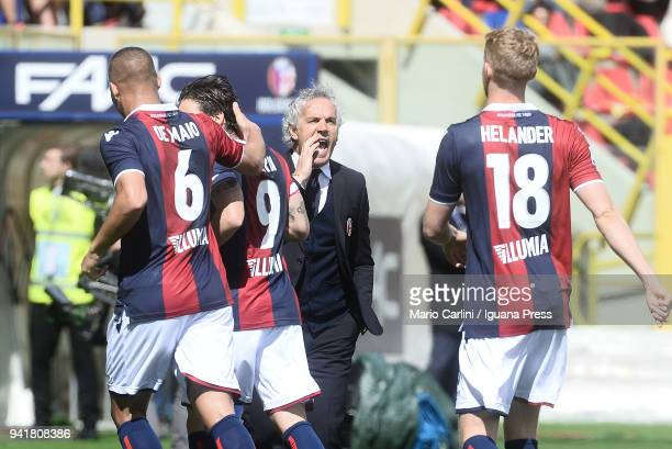 Roberto Donadoni head coach of Bologna FC talks to his players during the serie A match between Bologna FC and AS Roma at Stadio Renato Dall'Ara on...