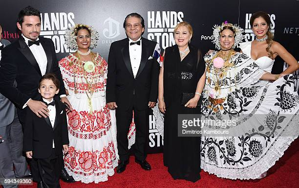 Roberto Duran and Felicidad Duran pose with guests at the Hands Of Stone US premiere at SVA Theater on August 22 2016 in New York City